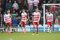 Doncaster Rovers' players look dejected as the game ends<br /> <br /> Photographer Mick Walker/CameraSport<br /> <br /> The EFL Sky Bet League One - Doncaster Rovers v Rotherham United - Saturday 11th November 2017 - Keepmoat Stadium - Doncaster<br /> <br /> World Copyright &copy; 2017 CameraSport. All rights reserved. 43 Linden Ave. Countesthorpe. Leicester. England. LE8 5PG - Tel: +44 (0) 116 277 4147 - admin@camerasport.com - www.camerasport.com