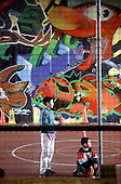 Basketball under the Westway at Acklam Road Playspace in West London, which caters for children with and without disabilities.