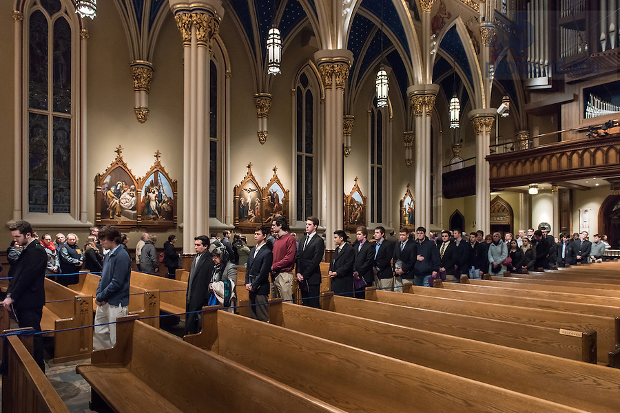 Mar. 3, 2015; Visitors wait in line to pay their respects to the late President Emeritus Rev. Theodore M. Hesburgh, C.S.C. in the Basilica of the Sacred Heart. (Photo by Matt Cashore/University of Notre Dame)