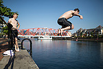 © Joel Goodman - 07973 332324 . 19/07/2016 . Salford , UK . People cooling off in the water at Salford Quays , on the hottest day of the year so far . Photo credit : Joel Goodman