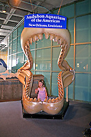 Girl in giant shark jaws Audubon Aquarium of the Americas New Orleans Louisiana