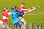 Tralee IT's Michael Kiely and Cork College's l-r: no.5 Richard Illis and no.6 Gary Grey..
