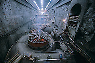 Quebec, Canada, February 1980.   The James Bay Project, a series of hydroelectric power stations on the La Grande River in northwestern Quebec, Canada, built by the state-owned utility Hydro-Quebec.  The project covers an area of the size of the State of New York and is one of the largest hydroelectric systems in the world, with a generating capacity of 16,527 megawatts. - Workers installing the water powered turbines.