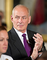 White House Chief of Staff General John Kelly applauds after United States President Donald J. Trump made remarks at an event with small businesses in the East Room of the White House in Washington, DC on Tuesday, August 1, 2017. Photo Credit: Ron Sachs/CNP/AdMedia