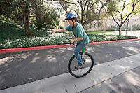 Occidental College student Ian Convy '17 rides his unicycle up Gilman Road on Feb. 3, 2015. Ian has been riding for about three and a half years and is currently training for a round-trip ride from Oxy to Long Beach. (Photo by Marc Campos, Occidental College Staff Photographer)