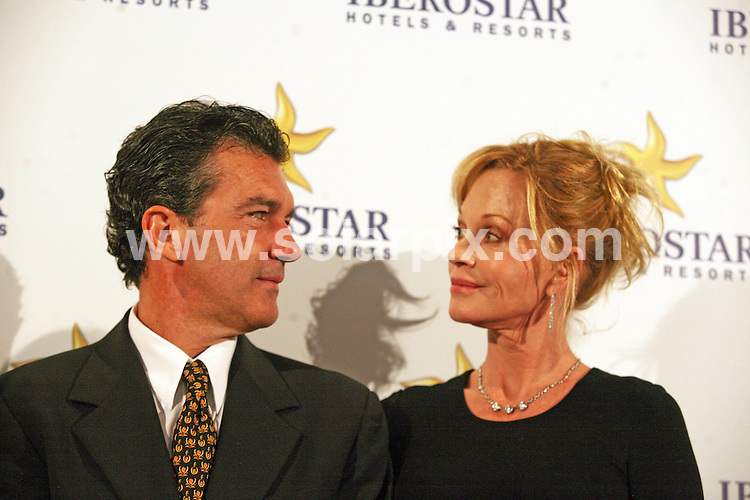 **ALL ROUND PICTURES FROM SOLARPIX.COM**                                             **WORLDWIDE SYNDICATION RIGHTS EXCEPT SPAIN & SOUTH AMERICA - NO SYNDICATION IN SPAIN OR SOUTH AMERICA**                                                                                  Caption: Iberostar Hotels & Resorts opens the Marbella Coral Beach hotel in Marbella, Costa del Sol, Spain. '' Antonio Banderas, Melanie Griffith and Mayor Muñoz Mariangeles Marbella..The Hotel which first opened in September 2010 has undergone a complete refurbishment specially designed for couples seeking rest and relaxation. Marbella, Spain. 13 April 2011                                                                              This pic: Antonio Banderas, Melanie Griffith                                                                                             JOB REF: 13142 MPA       DATE: 13_04_2011                                                           **MUST CREDIT SOLARPIX.COM OR DOUBLE FEE WILL BE CHARGED**                                                                      **MUST AGREE FEE BEFORE ONLINE USAGE**                               **CALL US ON: +34 952 811 768 or LOW RATE FROM UK 0844 617 7637**