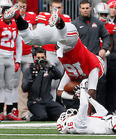 Ohio State Buckeyes quarterback J.T. Barrett (16) flips during a tackle while wrestling for the ball with Indiana Hoosiers cornerback Rashard Fant (16) in the second quarter of their game at Ohio Stadium in Columbus, Ohio on November 22, 2014. (Columbus Dispatch photo by Brooke LaValley)