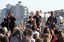 Hillary Scott left, Charles Kelley and Dave Haywood of Lady Antebellum performs on the roof of the JetBlue building as part of the Live From T5 Concert Series, on Thursday, May 2, 2013 in Queens, New York. (Photo by www.soulb.photoshelter.com)