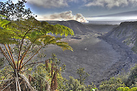 Halema'uma'u crater of Kilauea Volcano billows ash and steam, Hawai'i Volcanoes National Park, Big Island.