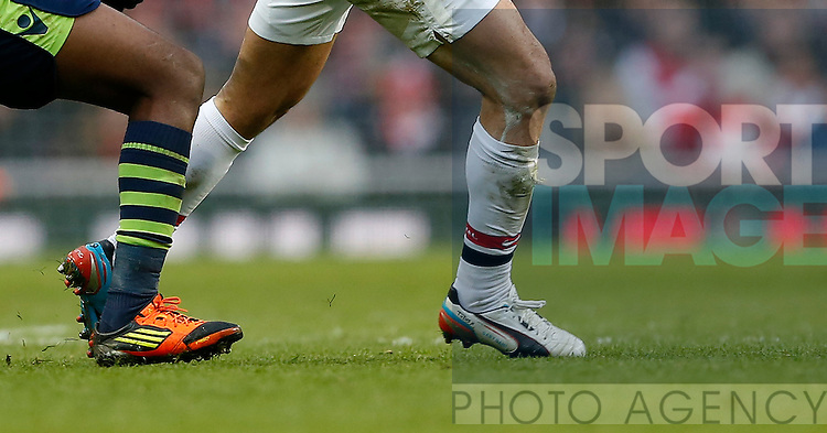 Arsenal's Mikel Arteta with the signature of his right boot saying 'Tubes'..Arsenal v Aston Villa - Premier League - Emirates Stadium, London- 23/02/13 - Picture David Klein/Sportimage