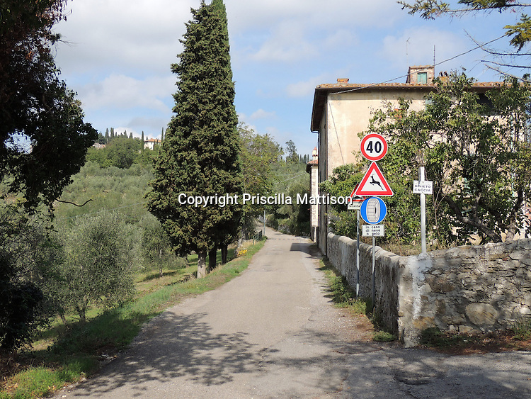 Val d'Arno, Italy - October 5, 2012:  Road signs in a small Tuscan town.