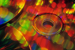 Multi colored stack of cd's reflecting rainbow of colors Marysville Washington State USA.