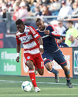 FC Dallas defender Fabian Castillo (11) dribbles as New England Revolution defender Andrew Farrell (2) defends..  In a Major League Soccer (MLS) match, FC Dallas (red) defeated the New England Revolution (blue), 1-0, at Gillette Stadium on March 30, 2013.