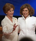Coral Gables, FL - September 30, 2004 -- First lady Laura Bush, left, and Theresa Heinz Kerry, right, appear together after their husbands. United States President George W. Bush and Senator John F. Kerry (Democrat of Massachusetts) debated in the first of their three scheduled meetings at the University of Miami in Coral Gables, Florida on September 30, 2004..Credit: Ron Sachs / CNP