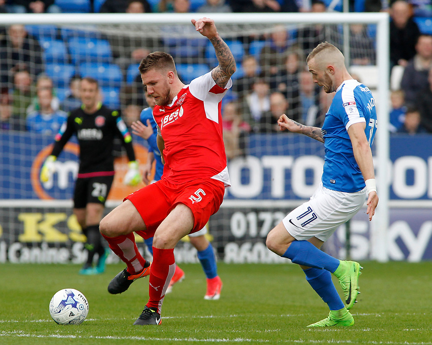 Fleetwood Town's Ashley Eastham is chased down by Peterborough United's Marcus Maddison<br /> <br /> Photographer David Shipman/CameraSport<br /> <br /> The EFL Sky Bet League One - Peterborough United v Fleetwood Town - Friday 14th April 2016 - ABAX Stadium  - Peterborough<br /> <br /> World Copyright &copy; 2017 CameraSport. All rights reserved. 43 Linden Ave. Countesthorpe. Leicester. England. LE8 5PG - Tel: +44 (0) 116 277 4147 - admin@camerasport.com - www.camerasport.com