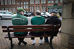 Three home fans sitting on a bench outside the West Stand at Easter Road stadium before the Scottish Championship match between Hibernian and visitors Alloa Athletic. The home team won the game by 3-0, watched by a crowd of 7,774. It was the Edinburgh club's second season in the second tier of Scottish football following their relegation from the Premiership in 2013-14.
