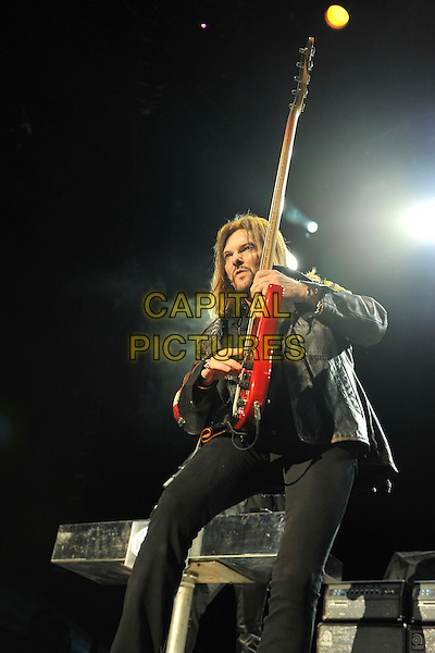 Styx - Ricky Phillips.Styx performing live at Wembley Arena, London, England..June 4th, 2011.stage concert live gig performance music half length black  jacket bass guitar.CAP/MAR.© Martin Harris/Capital Pictures.
