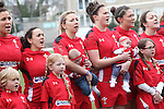 The Wales team along with their children line up for the anthems.<br /> 6 Nations Championship<br /> Wales v Ireland Women<br /> St Helens Swansea<br /> 15.03.15<br /> &copy;Steve Pope - SPORTINGWALES