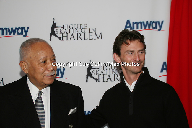 Former Mayor David Dinkins and Olympic skater Todd Eldredge at the 2009 Skating with the Stars - a benefit gala for Figure Skating in Harlem on April 6, 2009 at Wollman Rink, Central Park, NYC, NY. (Photo by  Sue Coflin/Max Photos)