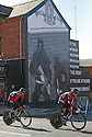 Team BMC RACING (USA) cycle past pro-British Loyalist murals of east Belfast during practice session before the 2014 Giro d'Italia cycling race in Belfast, Northern Ireland, 09 May 2014. Belfast is hosting the Giro d'Italia Big Start (Grande Partenza) with three days of cycling action from 9 to 11 May 2014.