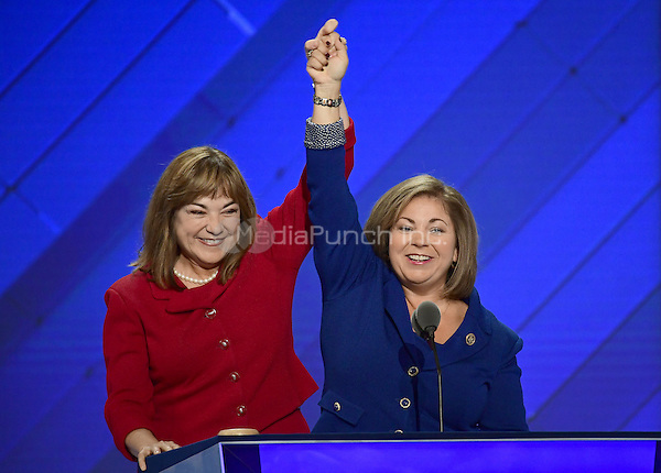 United States Representative Linda Sanchez (Democrat of California), right, accompanied by her sister US Representative Loretta Sanchez (Democrat of California), left, makes remarks at the 2016 Democratic National Convention at the Wells Fargo Center in Philadelphia, Pennsylvania on Monday, July 25, 2016.<br /> Credit: Ron Sachs / CNP/MediaPunch<br /> (RESTRICTION: NO New York or New Jersey Newspapers or newspapers within a 75 mile radius of New York City)
