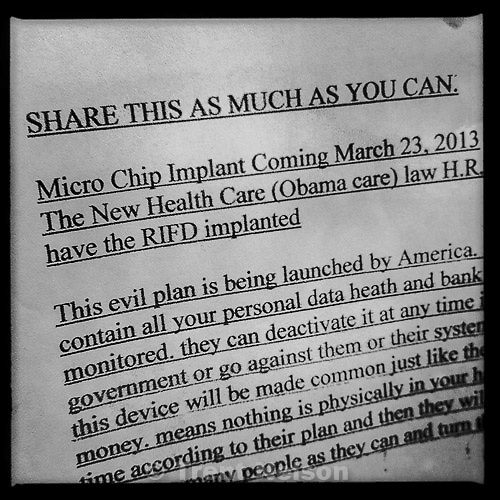 flier on gas station bulletin board about micro chip RFID implant coming with obamacare, Tuesday April 2, 2013.