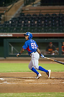 AZL Rangers second baseman Yonny Hernandez (59) follows through on his swing against the AZL Giants on August 22 at Scottsdale Stadium in Scottsdale, Arizona. AZL Rangers defeated the AZL Giants 7-5. (Zachary Lucy/Four Seam Images via AP Images)