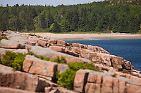 A sandy beach is pictured through the rocky shore of Acadia National Park on Mount Desert Island in Maine Wednesday June 19, 2013. Created as Lafayette National Park in 1919 and renamed Acadia in 1929, the park includes mountains, an ocean shoreline, woodlands, and lakes.