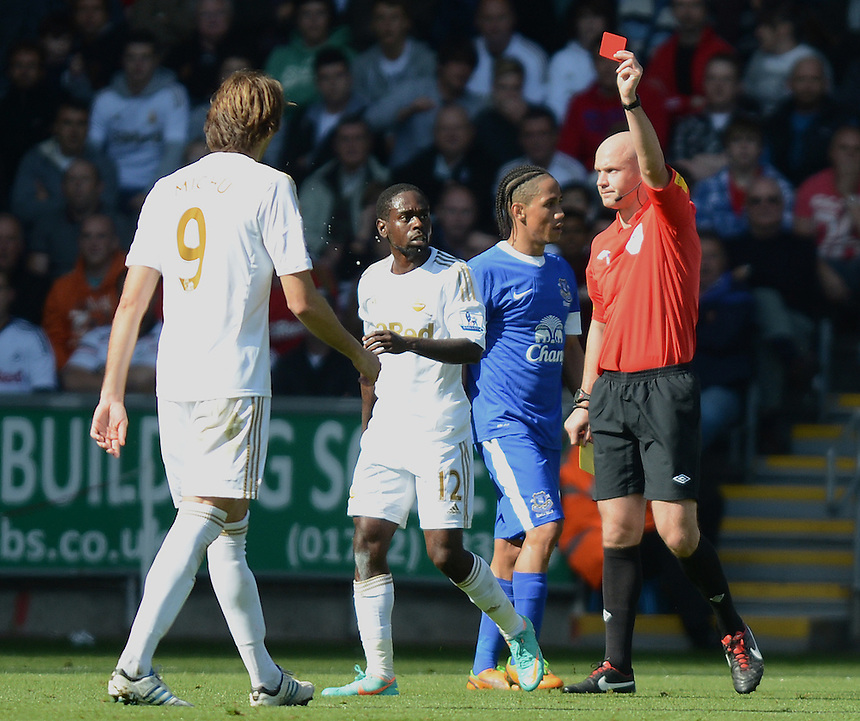 Referee Anthony Taylor shows Swansea City's Nathan Dyer the Red Card after Dyer picked up his second yellow card of the game..Football - Barclays Premiership - Swansea City v Everton - Saturday 22nd September 2012 - Liberty Stadium - Swansea..