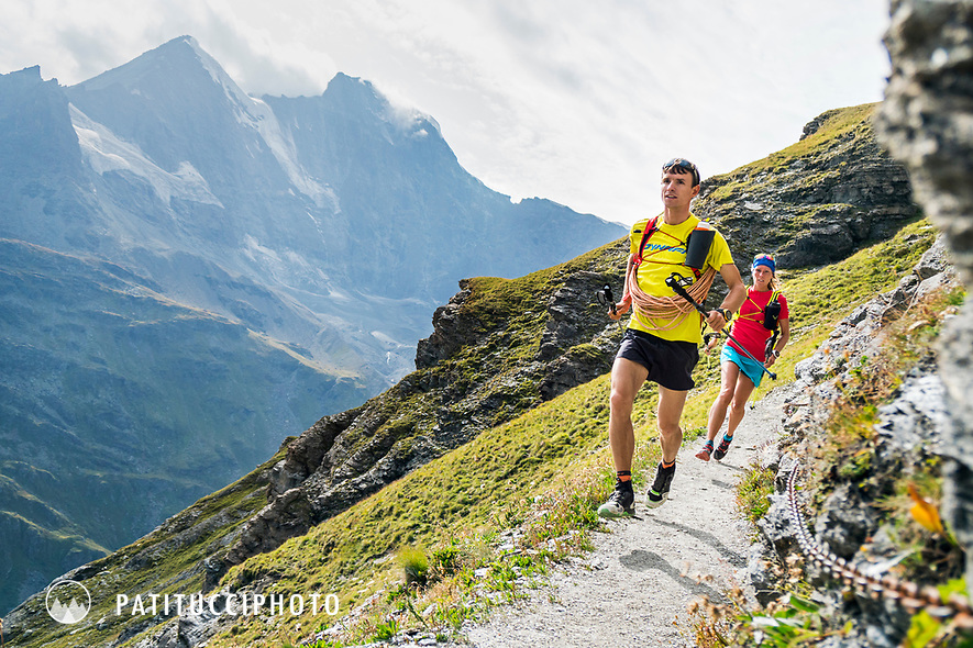 The Chamonix to Zermatt Glacier Haute Route. In late August 2017, we ran the tour in mountain running gear, running shoes, and all the necessary glacier travel and crevasse rescue gear. Running to the Chanrion Hut on a trail with chains in place due to a steep drop.