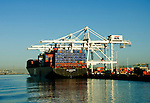 California, Oakland: A container ship loading in the Oakland Harbor..Photo #: 34-casanf79037.Photo © Lee Foster 2008