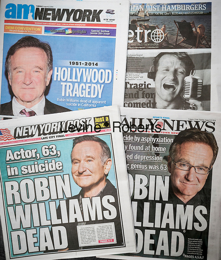 Front pages and headlines of New York tabloid newspapers on Tuesday, August 12, 2014 report on the previous days death of actor and comedian Robin Williams. Williams died in his Marin County, CA home at the age of 63, an apparent suicide. (© Richard B. Levine)