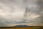 Storm over the Judith Mountains, harvested wheat field, Danvers, Montana