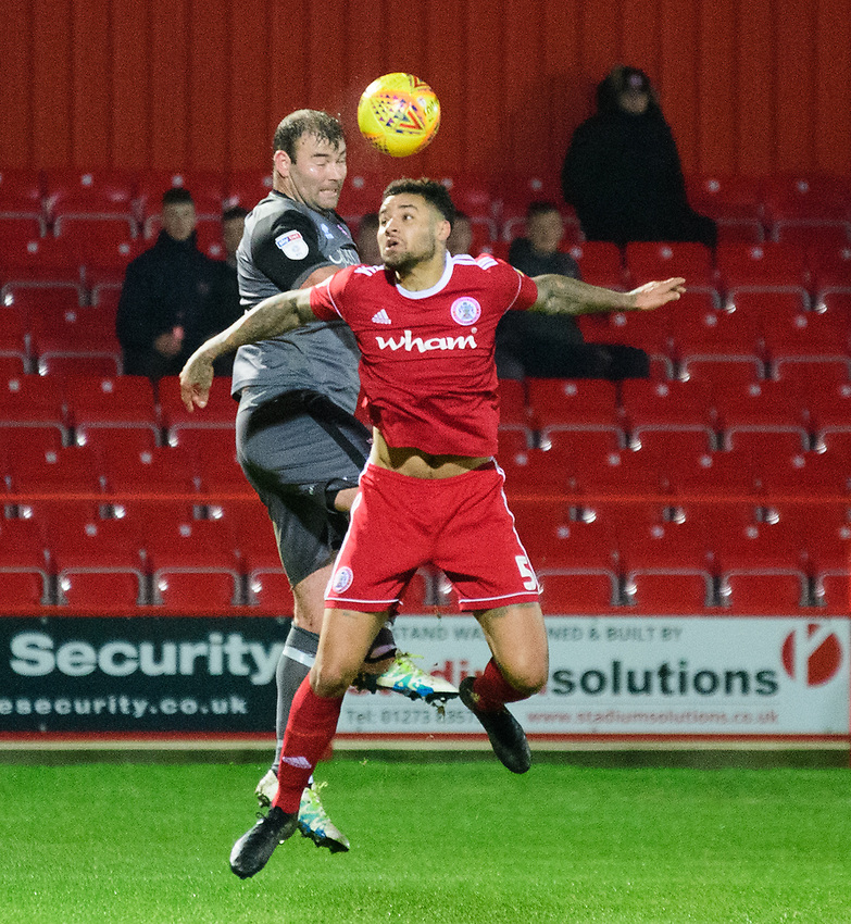 Lincoln City's Matt Rhead vies for possession with Accrington Stanley's Ben Richards-Everton<br /> <br /> Photographer Andrew Vaughan/CameraSport<br /> <br /> The EFL Checkatrade Trophy Second Round - Accrington Stanley v Lincoln City - Crown Ground - Accrington<br />  <br /> World Copyright © 2018 CameraSport. All rights reserved. 43 Linden Ave. Countesthorpe. Leicester. England. LE8 5PG - Tel: +44 (0) 116 277 4147 - admin@camerasport.com - www.camerasport.com