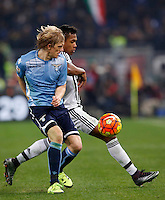 Calcio, Serie A: Lazio vs Juventus. Roma, stadio Olimpico, 4 dicembre 2015.<br /> Lazio&rsquo;s Dusan Basta, left, and Juventus&rsquo; Alex Sandro fight for the ball during the Italian Serie A football match between Lazio and Juventus at Rome's Olympic stadium, 4 December 2015.<br /> UPDATE IMAGES PRESS/Riccardo De Luca