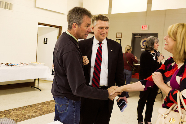 April 6, 2014. Durham, North Carolina.<br />  Greg Brannon, left and Mark Harris, center, are two of eight Republican candidates running for Democrat Kay Hagan's Senate seat.<br /> As the the primary scheduled for May 6th grows near, several of the the eight Republican candidates running for the US Senate seat of incumbent Democrat Kay Hagan have increased their public visibility, appearing at events such as the Durham County Lincoln Douglas Lunch, where each candidate was given a few minutes to address the gathered Republican friendly crowd.