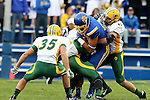 BROOKINGS, SD - OCTOBER 3:  Cam Jones #85 from South Dakota State is brought down by MJ Stumpf #41 from North Dakota State in the first quarter of their game Saturday night at Coughlin Alumni Stadium in Brookings. (Photo by Dave Eggen/Inertia)