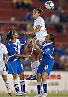 Action photo of Carli Lloyd of USA (L) and Gladys Suriano of Guatemala (R) at the 2010 CONCACAF Women's World Cup Qualifying tournament held at Estadio Quintana Roo in Cancun, Mexico.