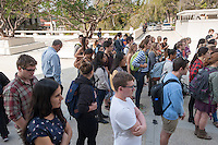 Oxy President Jonathan Veitch, far left, listens. Occidental College students march in a rally organized by Fossil Free Occidental on Nov. 14, 2014. The group hopes to end Oxy's reliance on fossil fuels by freezing all investments in the 200 largest fossil-fuel companies (measured by their proven carbon reserves in oil, gas or coal) and over the next five to ten years sell the stock in these same companies, and then reinvest 5%, at minimum, of the divested portfolio in socially responsible investments. (Photo by Marc Campos, Occidental College Photographer)