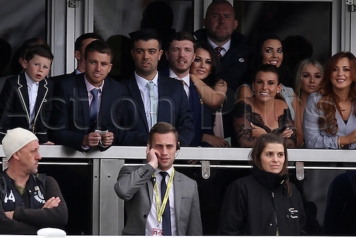 09.04.2016. Aintree, Liverpool, England. Crabbies Grand National Festival Day 3. Coleen Rooney with son Kai and friends enjoying the racing.