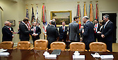 Key business leaders talk amongst themselves prior to the arrival of United States President Donald Trump at a breakfast and listening session in the Roosevelt Room of the White House in Washington, DC on Monday, January 23, 2017.<br /> Credit: Ron Sachs / Pool via CNP