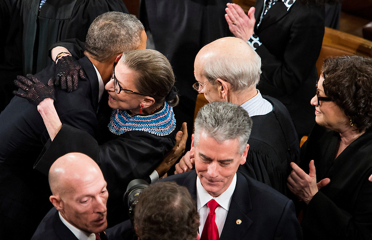 UNITED STATES - JANUARY 20: President Barack Obama hugs Supreme Court Justice Ruth Bader Ginsburg as he arrives in the House chamber in the U.S. Capitol to deliver his State of the Union address on Tuesday, Jan. 20, 2015. (Photo By Bill Clark/CQ Roll Call)