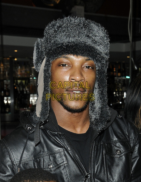 ASHLEY WALTERS .At the Mother's Day brunch, Planet Hollywood, London, England, UK,.March 14th 2010..Mothering Sunday portrait headshot beard goatee facial hair black leather  grey gray fur deer stalker flap ear hat .CAP/CAN.©Can Nguyen/Capital Pictures