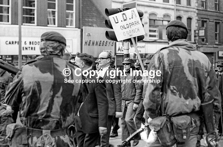 What is believed to be the Ulster Defence Association's first public appearance, since its formation in September 1971, passes long Upper North Street, Belfast, Saturday 18th March 1972, on its way to the Shankill Road, a loyalist heartland. 197203180342b <br />