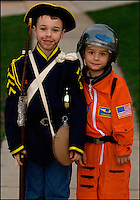 Two children (model released) head out dressed in costumes for a night of trick or treating festivities.