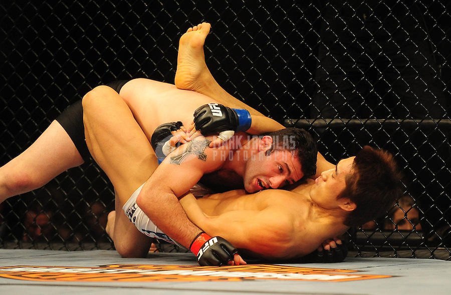 Jan. 31, 2009; Las Vegas, NV, USA; UFC fighter Karo Parisyan (top) against Dong Hyun Kim during the welterweight bout in UFC 94 at the MGM Grand Hotel and Casino. Mandatory Credit: Mark J. Rebilas-