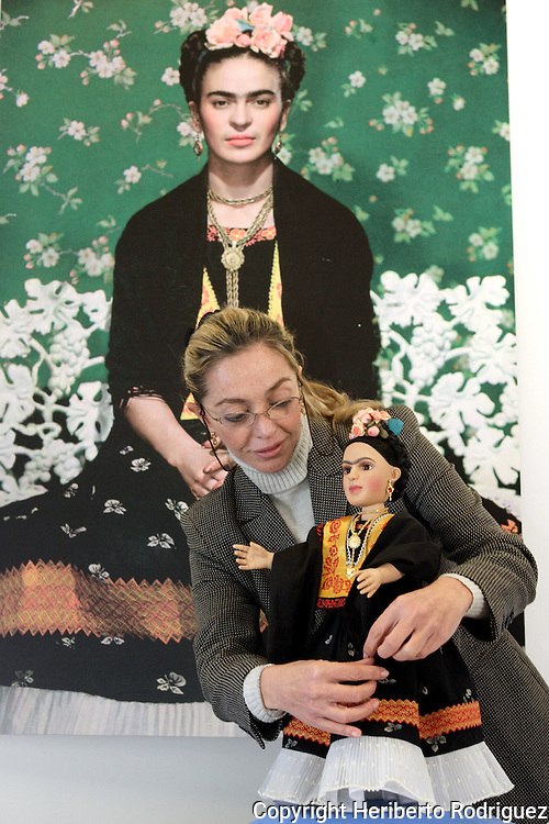 Cristina Dorsett arranges a Frida Khalo collection doll as is annouced to be launched in Mexico City on December 14. The 20-inch Frida Khalo doll is clad in a traditional Mexican dress. Miss Dorsett is the owner of the doll factory where they were made. Frida Khalo Corporation, leaded by Frida's niece Isolda Khalo, has marketed Frida Kahlo jewellery and clothing after winning the rights to register the name as a brand. Photo by Heriberto Rodriguez