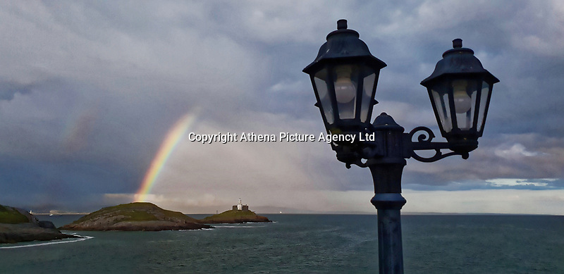 A rainbow was seen over Mumbles Head from Bracelet Bay. Thursday 06 June 2019