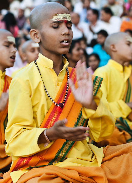 Ganga Aarthi ritual at the banks of the Ganges River, Parmarth Niketan Ashram, Rishikesh, India. More than 100 boys ages 5 to 18 join their guru in a daily Ganga Aarthi ceremony to give thanks to the Mother Ganga for all her blessings.