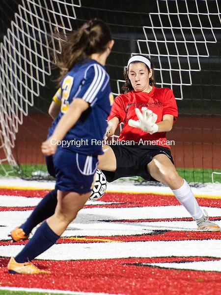 SOUTHBURY, CT - 24 September 2015-092415EC10-- Pomperaug's goalie, Elyssa Kipperman , blocks a shot from Weston's Charlotte Cenatiempo Thursday night in Southbury. Erin Covey Republican-American.